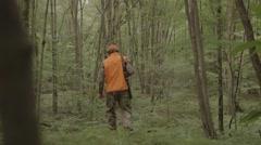 Gun hunter walking through the woods - stock footage