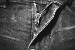 zip in jean black and white tone color style - stock photo