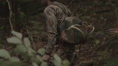 Tracking Medium/Wide shot of an Archer through the woods. Stock Footage