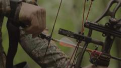 Close up Moving bow from Tree Hook to drawing and taking a shot.mp4 - stock footage