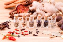 Assortment of Thai food Cooking ingredients in glass bottles on wooden backgr - stock photo