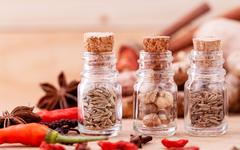 Stock Photo of Assortment of Thai food Cooking ingredients in glass bottles on wooden backgr