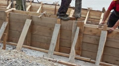 Concrete is being poured with continuous casting. - stock footage