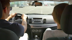 The man drive the car and talk with the woman (passenger), inside view Stock Footage