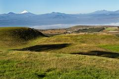 Stock Photo of Ruins of Cochasqui pyramids, archaeological site, with Cotopaxi in the