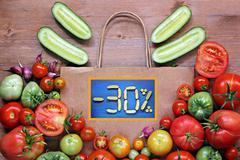 A still life with vegetables. Discount: -30% - stock photo