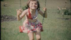 2438 - children play on the new swing set in backyard - vintage film home movie Stock Footage