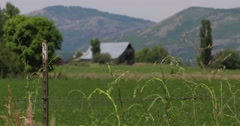 Barn and fence tight shot Stock Footage