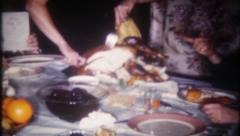 2441 - mom cuts the turkey, Thanksgiving dinner at home -vintage film home movie - stock footage