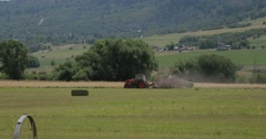 Hay baling release bale - stock footage