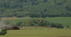 Hay baling compressed tight shot Stock Footage