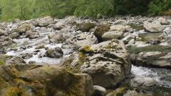 Mountain River with Rocks and Rapids  of White Water in Slow Motion Stock Footage