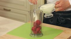 Chef is Mixing Strawberries, Yogurt and Honey in a Bowl to Make Smoothies Stock Footage