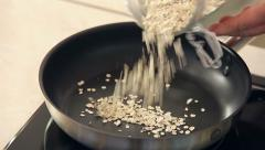 Chef is Drying Oat-Flakes on a Frying Pan - stock footage