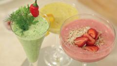 Presentation of Strawberry, Green Vegetables and Citrus Smoothies Stock Footage