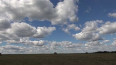 Timelapse stack of straw crop agricultural field landscape sky clouds - stock footage