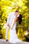 Stock Photo of couple kissing in honeymoon outdoor park