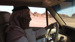 Stock Video Footage of Arab Man talking on Cell phone in the Deserts of the Wadi Rum, Jordan