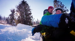 4K Footage: Son and father enjoying winter bobsleigh attraction Stock Footage