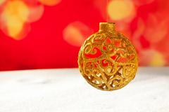 Arabesque christmas golden bauble on snow Stock Photos