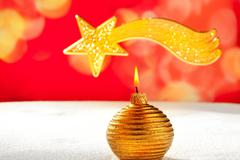Christmas golden candle and bethlehem star Stock Photos