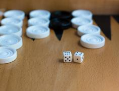 Wooden Backgammon board with white  slots and dice Stock Photos