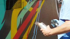 Slow motion, hand of a writer painting on a caravan Stock Footage