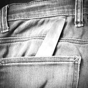 Stock Photo of knife in jean black and white tone color style