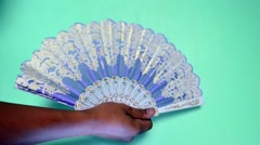 Traditional hand fan Stock Footage