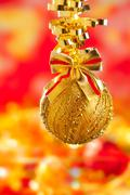 Stock Photo of Christmas tinsel golden glitter bauble loop