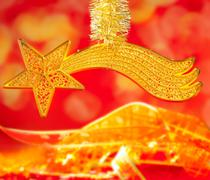 Christmas bethlehem comet gold star on red Stock Photos