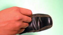 Polish an old shoes Stock Footage