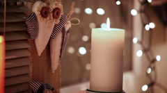 A footage of a Christmas candle flaming and beautiful embellishments Stock Footage