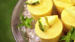 Homemade low calorie popsicles made with mango, pineapple and coconut milk at th Stock Footage