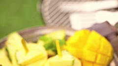 Stock Video Footage of Homemade low calorie popsicles made with mango, pineapple and coconut milk at th