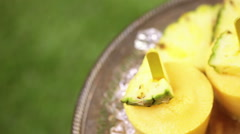 Homemade low calorie popsicles made with mango, pineapple and coconut milk at th - stock footage
