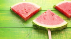 Yummy watermelon slice popsicles for refreshing treat. - stock footage