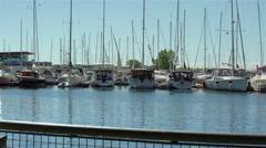 Boats docked at the marina by the lake. 4K UHD. Stock Footage