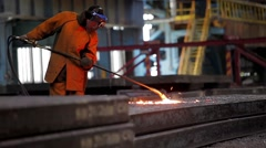 Worker polishing surface, imperfections of steel ingots Stock Footage