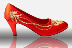 Chinese embroidered wedding shoes Stock Photos