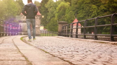Old dam in Liberec (Czech Republic) with people promenading by its cobbles - stock footage