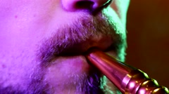 The mouth of a man smoking the traditional hubble-bubble or hookah - stock footage