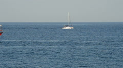 Ship yacht sailing on a blue ocean at sunset. Stock Footage