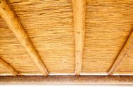 Cane sunroof with round wood beams Stock Photos