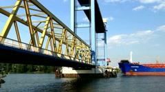 TL 4K Chemical cargo ship passing Kattwykdamm bridge Port of Hamburg Germany Stock Footage