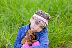 little girl with pet puppy mascot mini pinscher - stock photo
