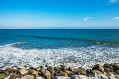 Stones along the rugged coast pacific ocean near Malibu, CA Stock Photos