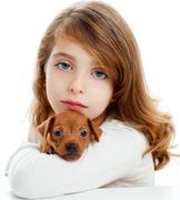 Brunette girl with puppy dog mini pinscher - stock photo