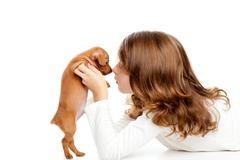 Brunette profile girl with dog puppy mini pinscher - stock photo
