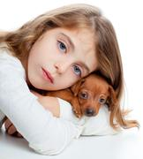Brunette kid girl with mini pinscher pet mascot dog Stock Photos